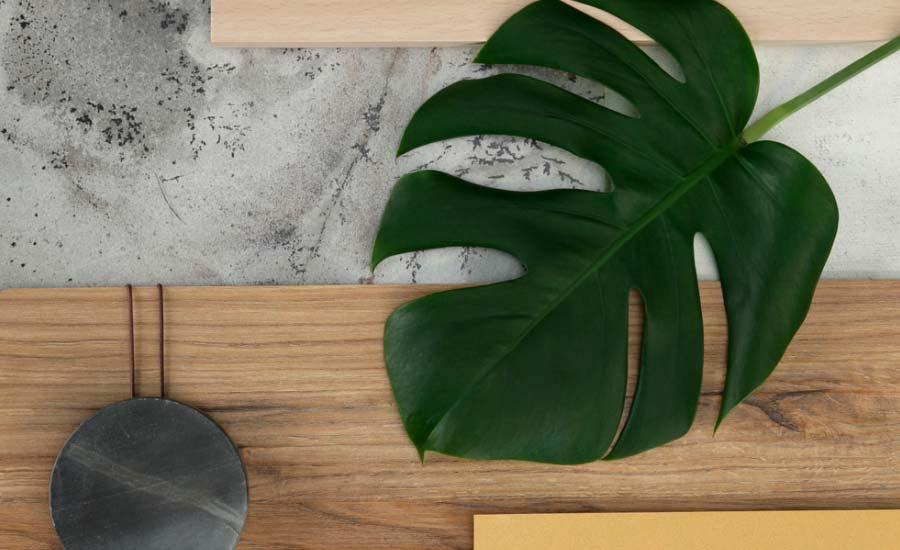 Ambientes na Casacor fazem uso de painéis de madeira para criar diferentes sensações ao reproduzir o desenho de madeiras, pedras e tecidos